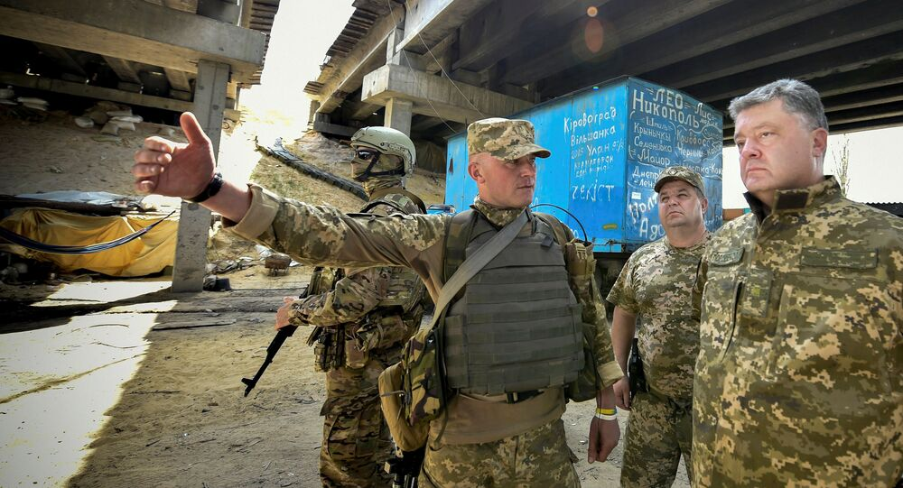 Ukrainian President Petro Poroshenko listens to a serviceman at a checkpoint in the village of Pisky (Peski), near Donetsk, Ukraine, June 24, 2016