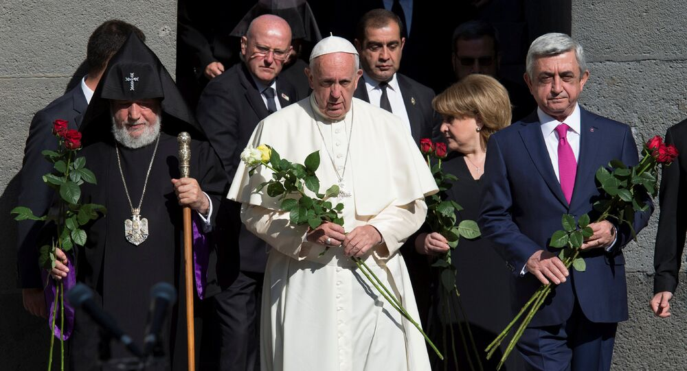 Pope Francis (C), Catholicos of All Armenians Karekin II (L) and Armenian President Serzh Sarksyan arrive for a ceremony in commemoration of Armenians killed by Ottoman forces during World War One at the Tzitzernakaberd Genocide Memorial in Yerevan, Armenia, June 25, 2016