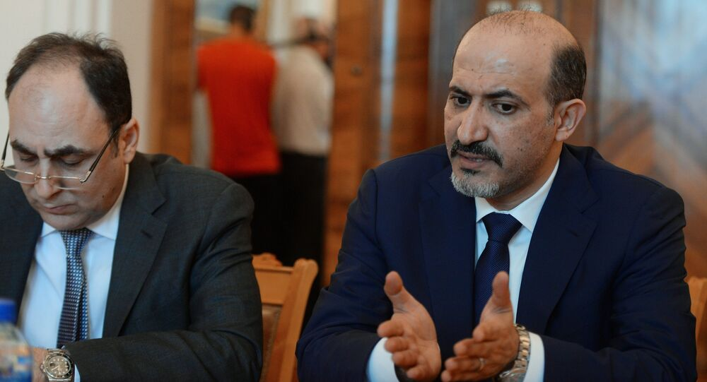 Ahmad al-Jarba, right, President of the National Coalition of Syrian Revolutionary and Opposition Forces, during a meeting between a Syrian opposition delegation and Russian Foreign Minister Sergei Lavrov in Moscow