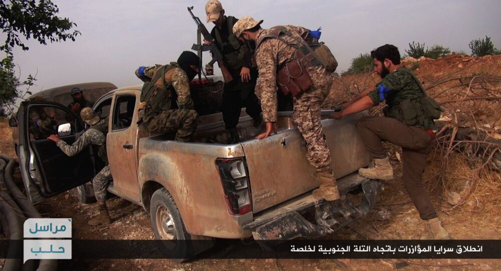 This image posted on the Twitter page of Syria's al-Qaida-linked Nusra Front on Wednesday, June 15, 2016, which is consistent with AP reporting, shows Nusra Front fighters on their vehicle preparing to leave and battle against Syrian troops and pro-government gunmen, at the hilltop of Khalsa village, southern Aleppo, Syria