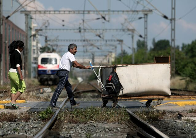 People cross railway tracks during a 48-hours public transport strike in Thessaloniki on 6 May, 2016