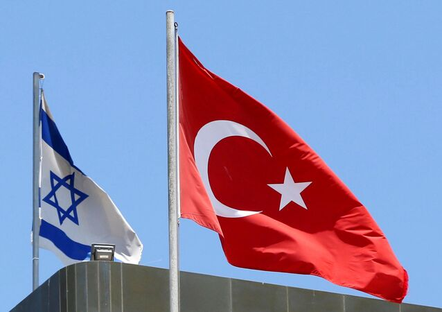 A Turkish flag flutters atop the Turkish embassy as an Israeli flag is seen nearby, in Tel Aviv, Israel, June 26, 2016