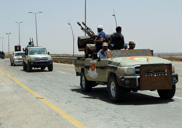 Forces loyal to Libya's UN-backed unity government patrol the entrance of Sirte as they advance to recapture the city from the Islamic State (IS) group jihadists on June 10, 2016