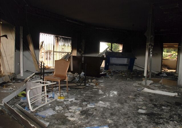 In this Sept. 12, 2012 file photo, glass, debris and overturned furniture are strewn inside a room in the gutted U.S. consulate in Benghazi, Libya, after an attack that killed four Americans, including Ambassador Chris Stevens