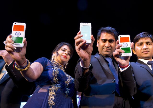 A Freedom 251 smartphone, which is to be priced at Indian Rupees 251 or USD 3.6 approximately, is shown during its release by officials of Ringing Bells Pvt. Ltd. in New Delhi, India, Wednesday, Feb. 17, 2016