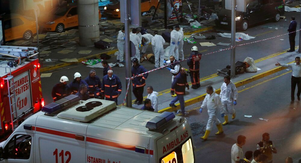 Forensic experts work outside Turkey's largest airport, Istanbul Ataturk, Turkey, following a blast, June 28, 2016.