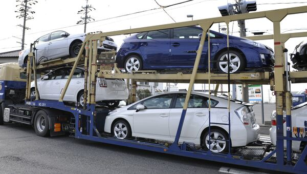 A carrier transports Toyota vehicles including the new Prius hybrid vehicles near the Toyota Motor Corp. Tsutsumi Plant in the town of Toyota, Japan's Aichi Prefecture - Sputnik International