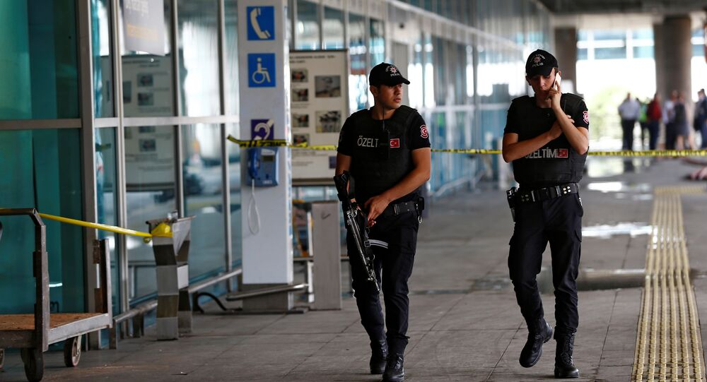 Police officers patrol at Turkey's largest airport, Istanbul Ataturk, following yesterday's blast June 29, 2016.