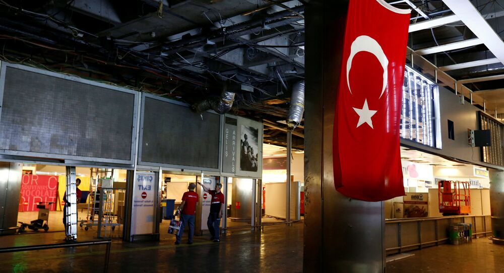 Workers repair the damaged parts of the terminal building at Turkey's largest airport, Istanbul Ataturk, Turkey, following yesterday's blast June 29, 2016