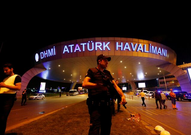 A riot police officer stands guard at the entrance of the Ataturk airport in Istanbul, Turkey, following a multiple suicide bombing, early June 29, 2016