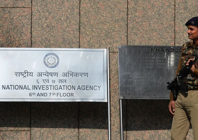 A Central Industrial Security Force guard stands outside the office of the National Investigation Agency (NIA) in New Delhi