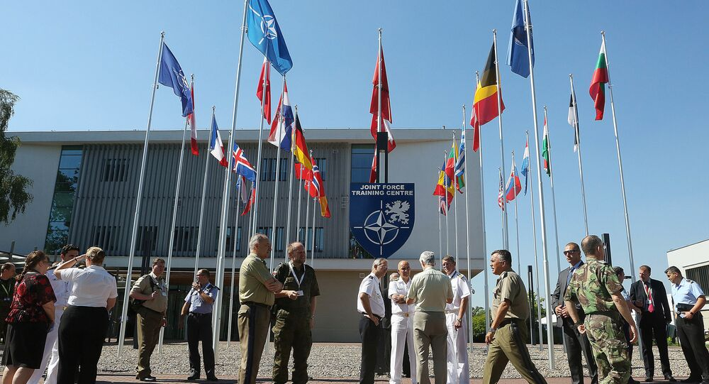 Participants of exercises in the field of computer systems are meeting in their break in front of the Joint Force Training Center in Bydgoszcz, Poland, Thursday, June 23, 2016.