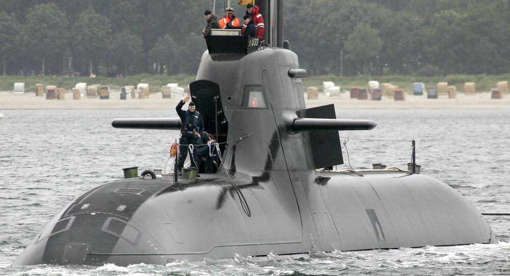 A crew member waves as the German submarine U 33 leaves the navy harbor of Eckernfoerde, northern Germany.