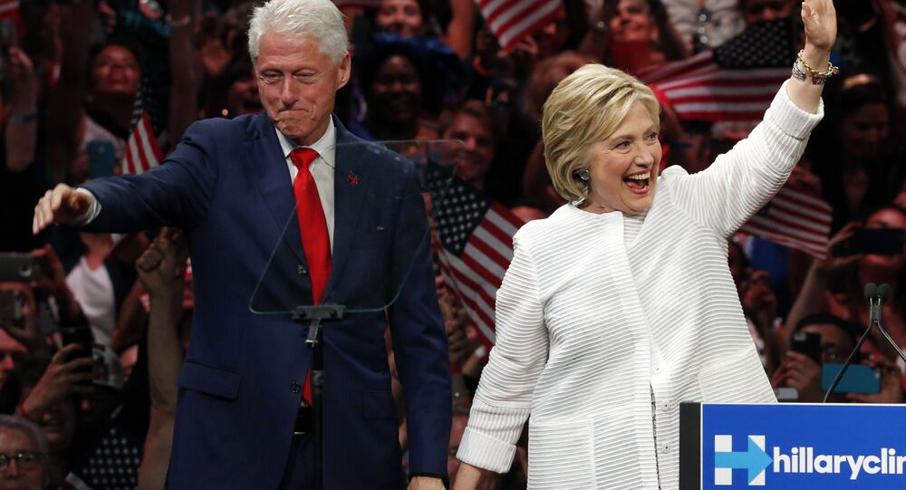 Former President Bill Clinton stands on stage with his wife, Democratic presidential candidate Hillary Clinton.