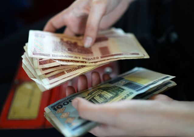 A woman counts Belarusian roubles