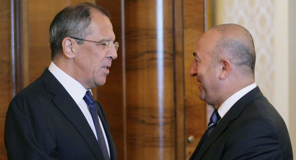 Russian Foreign Minister Sergei Lavrov (L) shakes hands with President of the Council of Europe's Parliamentary Assembly Mevlut Cavusoglu. (File)