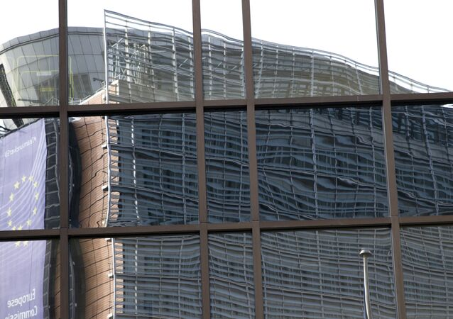European Union headquarters is reflected in the windows of the EU Council building prior to an EU summit in Brussels on Tuesday, 28 June 2016.