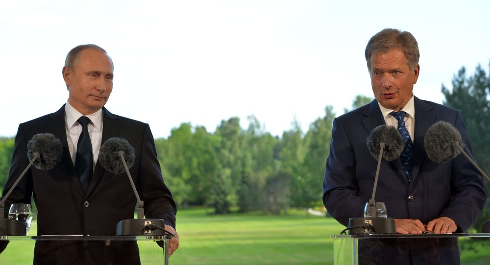 President Vladimir Putin (left) and President of the Republic of Finland Sauli Niinisto at a joint news conference following their meeting in Naantali