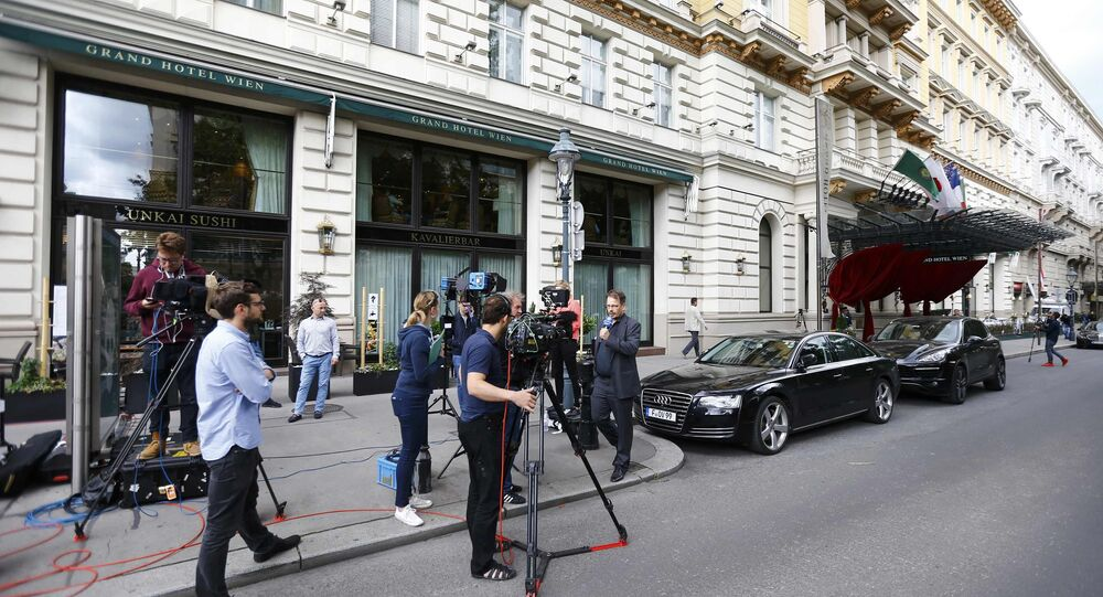 Members of the media gather outside a hotel where the International Association of Athletics Federations (IAAF) council holds a meeting in Vienna, Austria, June 17, 2016.