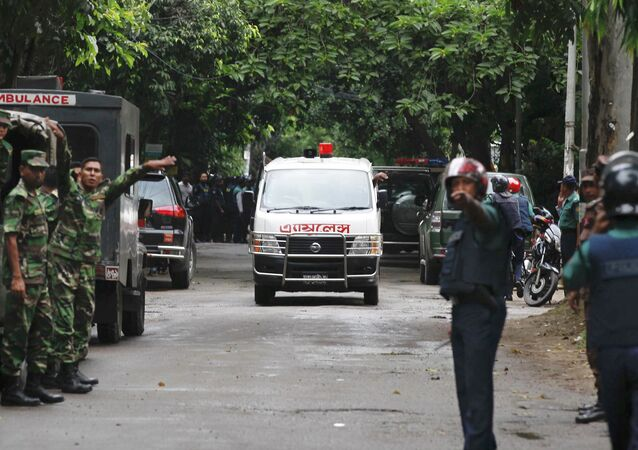 An ambulance transports bodies found at a restaurant popular with foreigners after heavily armed militants attacked it on Friday night in Dhaka, Bangladesh, Saturday, July 2, 2016