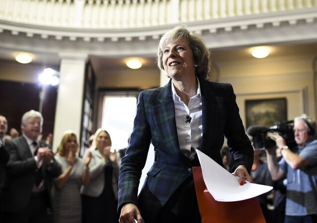 Britain's Home Secretary Theresa May attends a press conference in London, Britain