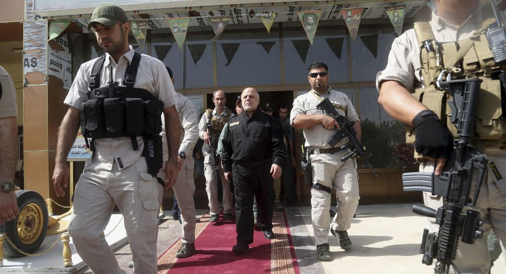 Iraq Prime Minister Haider al-Abadi, center, surrounded by his guards (File)