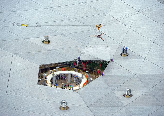 The last panel of China's world largest radio telescope named FAST, is installed in Pingtang county, Guizhou Province, China, July 3, 2016
