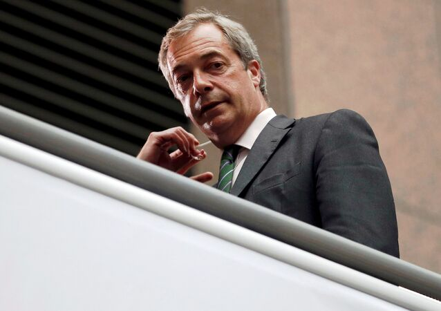 The former leader of the United Kingdom Independence Party Nigel Farage looks on as he waits for TV interview during the EU Summit in Brussels, Belgium, June 28, 2016.