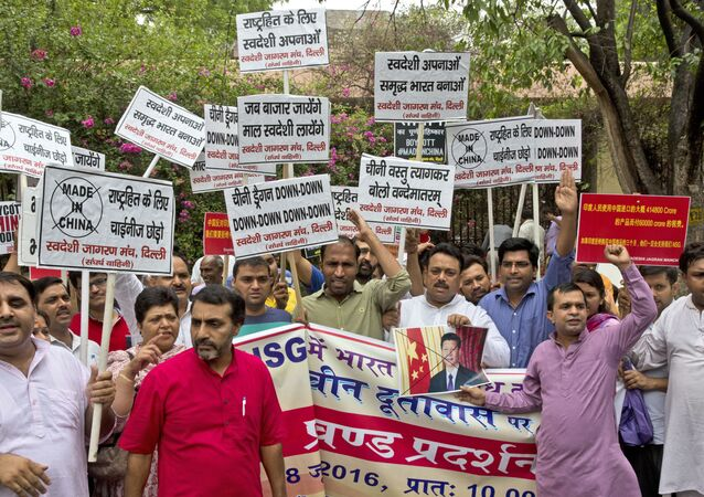 Activists of Swadeshi Jagaran Manch, a Hindu right wing organization promoting indigenous products, shout slogans during a protest near the Chinese embassy in New Delhi, India, Tuesday, June 28, 2016