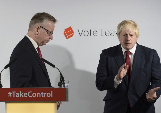 Britain's Justice Secretary Michael Gove (L) finishes speaking as Vote Leave campaign leader Boris Johnson applauds at the group's headquarters in London, Britain June 24, 2016.