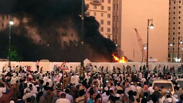 Muslim worshippers gather after a suicide bomber detonated a device near the security headquarters of the Prophet's Mosque in Medina, Saudi Arabia, July 4, 2016 - Sputnik International