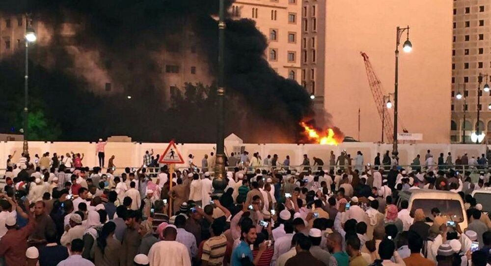 Muslim worshippers gather after a suicide bomber detonated a device near the security headquarters of the Prophet's Mosque in Medina, Saudi Arabia, July 4, 2016