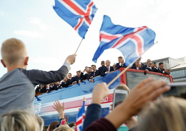 Icelandic soccer fans celebrate as their national team comes home to a hero's welcome from the Euro 2016 soccer championships in Reykjavik, Iceland, Monday July 4, 2016