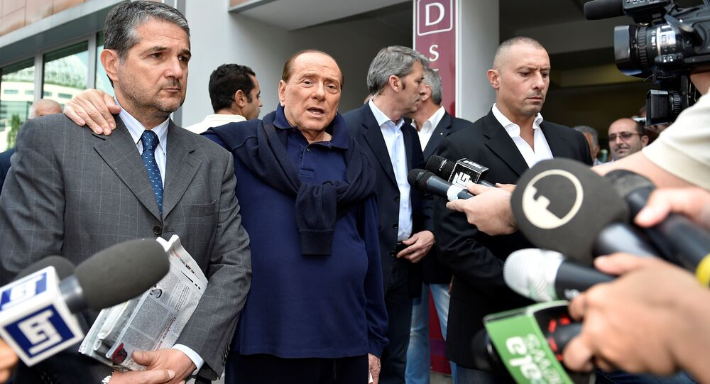 Italian tycoon and former prime minister Silvio Berlusconi talks with reporters as he leaves the hospital after a heart surgery in Milan, Italy July 5, 2016