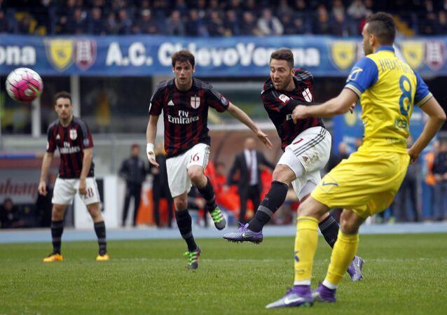 AC Milan's Andrea Bertolacci, right, kicks the ball during a Serie A soccer match against Chievo at Bentegodi stadium in Verona, Italy, Sunday, March 13, 2016