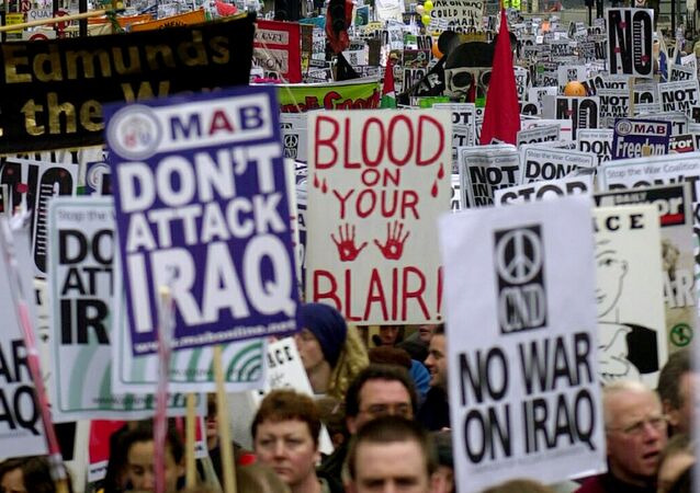 Opponents of the US-led war on Iraq demonstrate en masse in central London 15 February 2003 as tens of thousands of anti-war demonstrators around the world took the streets.