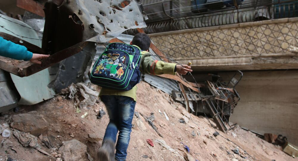 Child navigates through rubble and barbed wire in Aleppo, Syria (File)