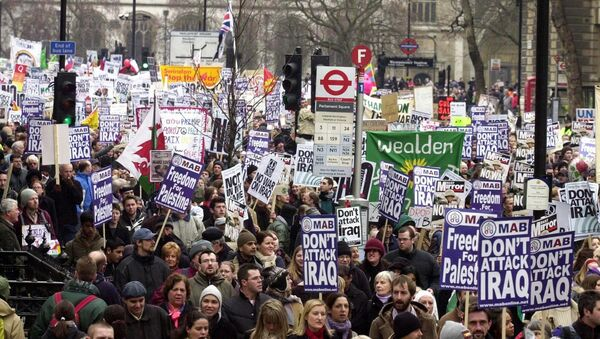 Demonstrators at the rally in London, 15 February 2003, as worldwide protests brought tens of thousands into the streets to show their opposition to a possible US-led war against Iraq. - Sputnik International