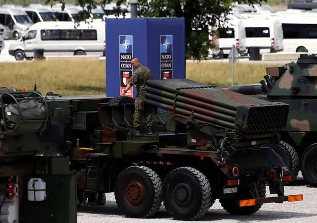 A file photo showing a Polish soldier prepares a military exhibition in front of the venue of the NATO Summit