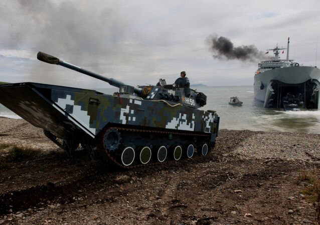 Infantry combat vehicles of the Navy of the People's Liberation Army of China come out into the shore