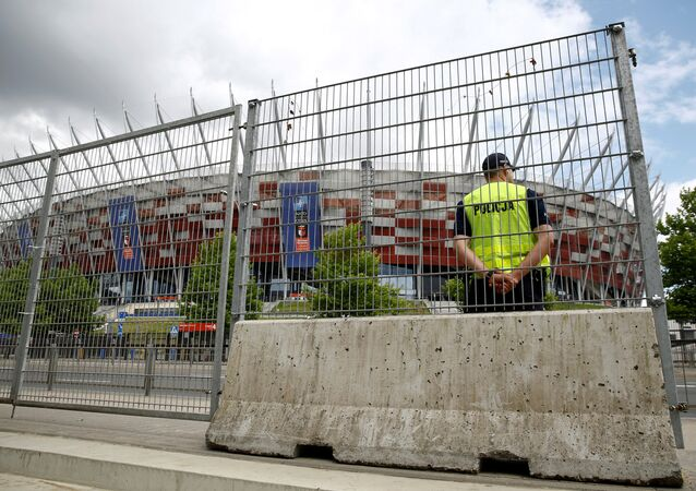 Polish police officer stands guard in front of the PGE National Stadium, the venue of the NATO Summit, which will start in two days, in Warsaw, Poland, July 6, 2016.