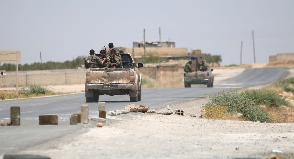 Syria Democratic Forces (SDF) ride vehicles along a road near Manbij, in Aleppo Governorate, Syria, June 25, 2016.