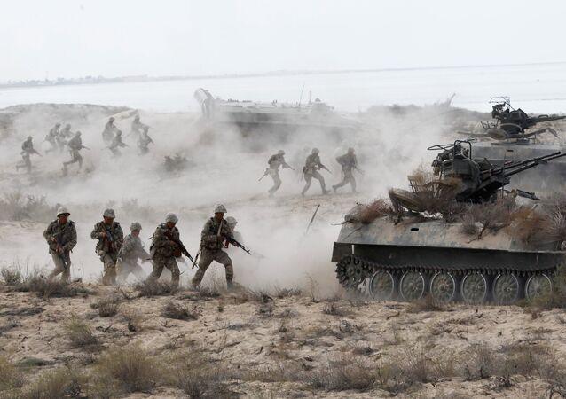 Kazakh riflemen charging an attack at the large-scale strategic exercises on the Oimasha range, Kazakhstan