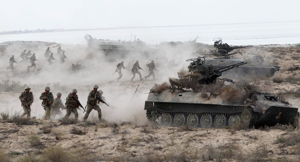 Kazakh riflemen charging an attack at the large-scale strategic exercises on the Oimasha range, Kazakhstan
