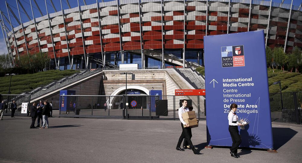 People walk outside PGE National Stadium, the venue of the NATO Summit, in Warsaw, Poland July 8, 2016.