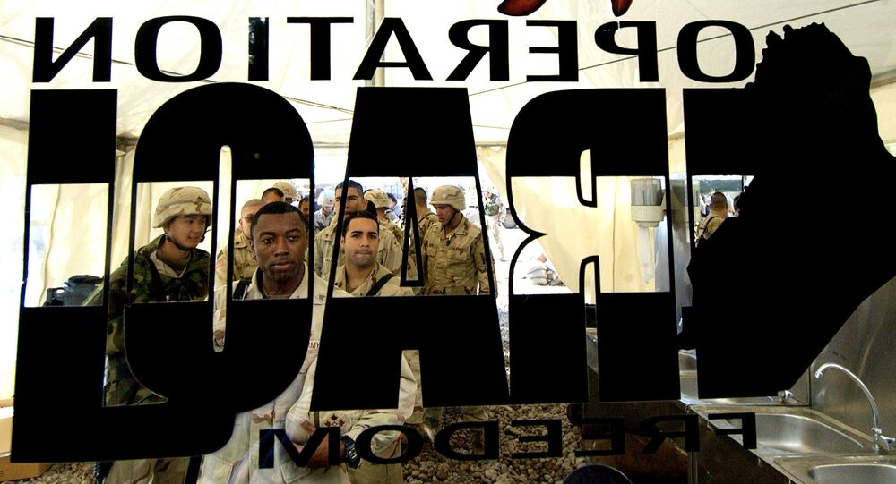 US soldiers from the 4th Infantry Division stand in a queue for their Christmas lunch out side a glass door where a logo of US army reading Operation Iraqi Freedom is pasted at a US base in Tikrit, 180 Kilometers (110 miles) north of Iraqi capital Baghdad, 25 December 2003
