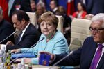 German Chancellor Angela Merkel (C) looks on next to German Foreign Minister Frank-Walter Steinmeier (R) and France's President Francois Hollande during the NATO Summit in Warsaw, Poland July 8, 2016.