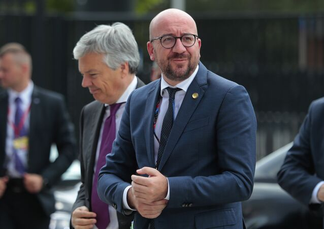 Belgian Prime Minister Charles Michel, right, arrives at the NATO summit in Warsaw, Poland, Friday, July 8, 2016.