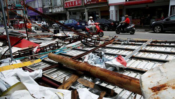 Motorcyclists ride past advertisement banners damaged by Typhoon Nepartak, in Taitung, Taiwan July 9, 2016 - Sputnik International