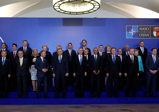 NATO Summit leaders gather for a family photo before a working dinner at the Presidential Palace in Warsaw, Poland July 8, 2016.